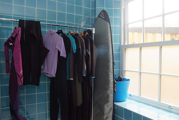 Wetsuit and surfboard rack