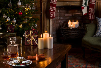 Presents and candles in a holiday cottage - Christmas in Cornwall
