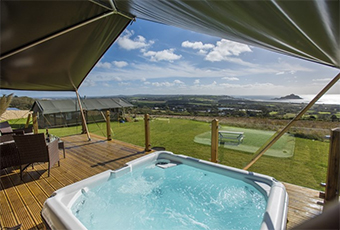 safari tent with hot tub and stunning sea views over st michael's mount