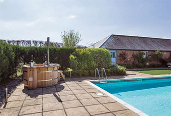 Enjoy a Devon cottage with a hot but and swiming pool