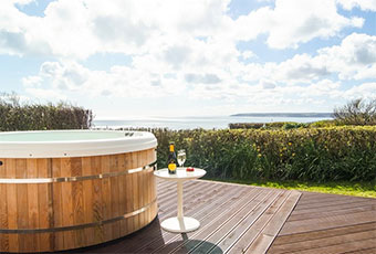 Take in the sea views from your hot bub in Cornwall