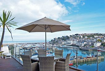 Sit back and enjoy watching the ebb and flow over Brixham harbour