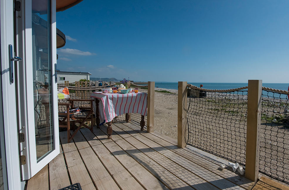 The Chalet on the Beach step straight out on to the beach at Lyme Regis. The perfect quirky cottage to spend New Year in Dorset.