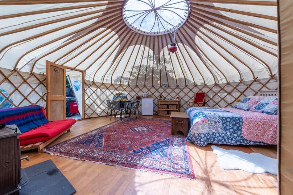 The beautiful interiors of Poppy Yurt glow as the light radiates through the space.