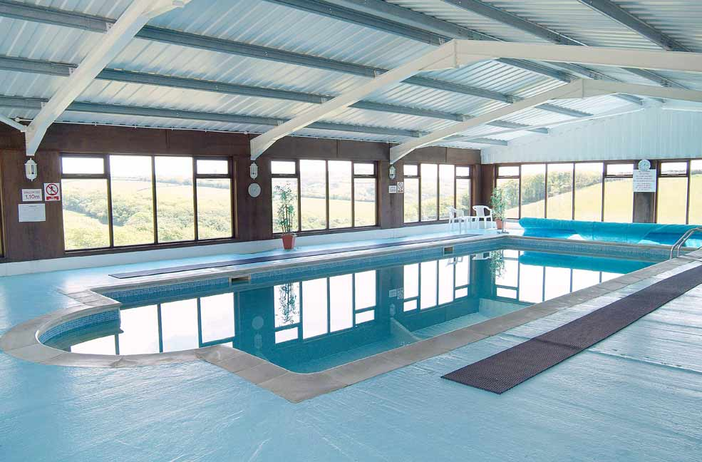 Woodlands Manor properties share the indoor swimming pool and the great views of Cornish countryside.