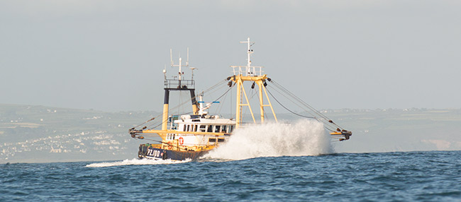 Newlyn trawler leaving mounts bay