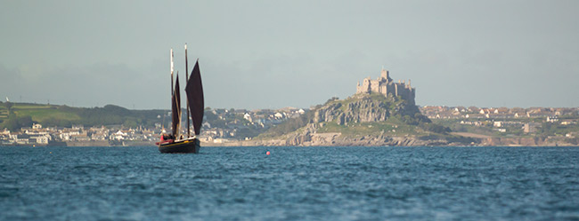 St Michaels Mount and boat view from Mousehole