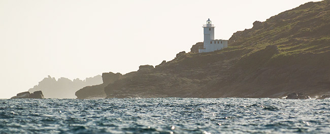 Tater Du lighthouse with Logan Rock coming in to view
