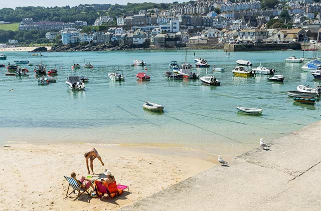 St Ives Harbour beach at high tide.