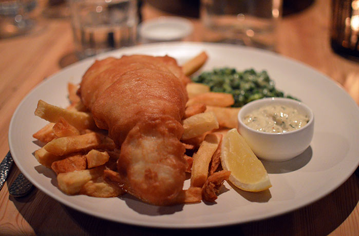 A hearty, tasty feast of fish and chips.