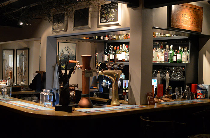 The well-stocked bar at The Hurstwood pub in Sussex.