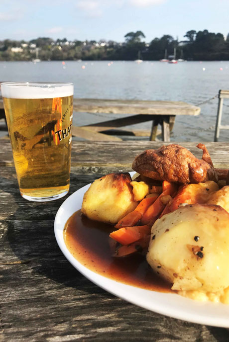 Overlook the river from the pontoon at the Pandora Inn while you enjoy a traditional Sunday carvery in Cornwall.