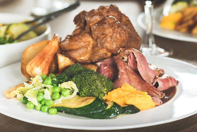 Tuck into this huge roast dinner at the brilliant Cornish Arms in St Merryn.