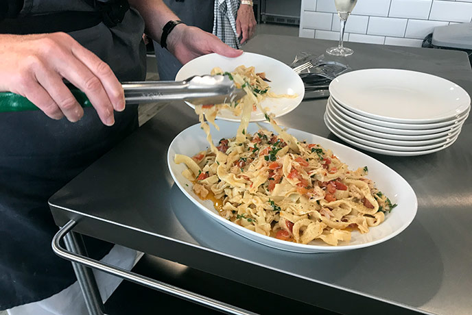 Tasting the delicious crab linguine made before our eyes.