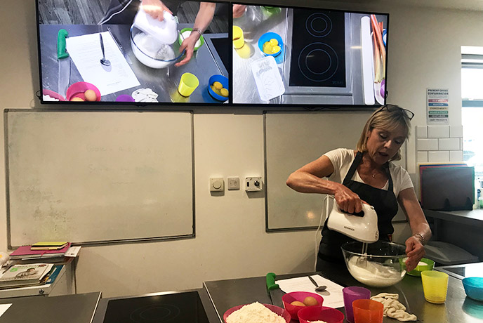 Maria showing us how it's done on the big screen at Truro School Cookery in Cornwall.
