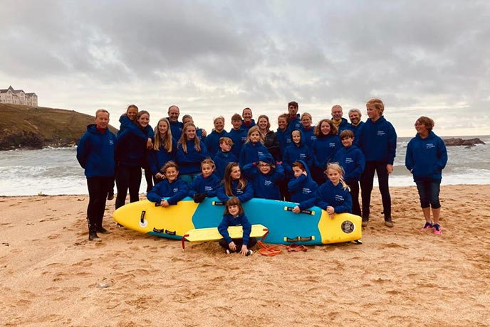 Classic Cottages donate a Rescue Board to Mullion Surf Life Saving Club