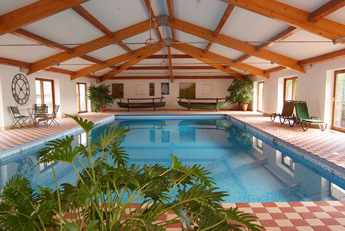The Cottage has a pretty pool house shared between two properties.