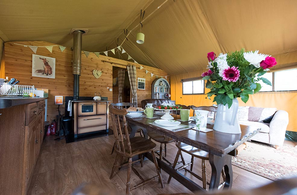 The lush interiors of our safari tent glamping is a far cry from what you'd expect from a camping holiday.