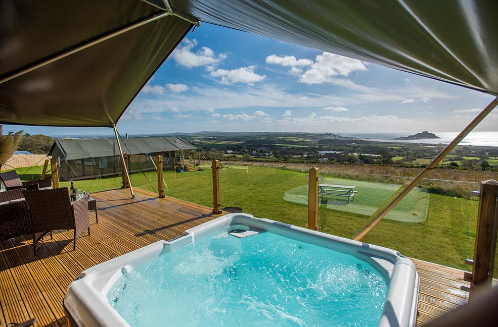 Relax in a hot tub overlooking St Michael's Mount at the Mount's View Retreat.