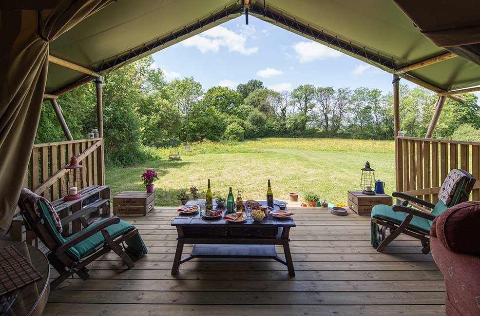 Revel in the joy of your own meadow next to your safari tent.