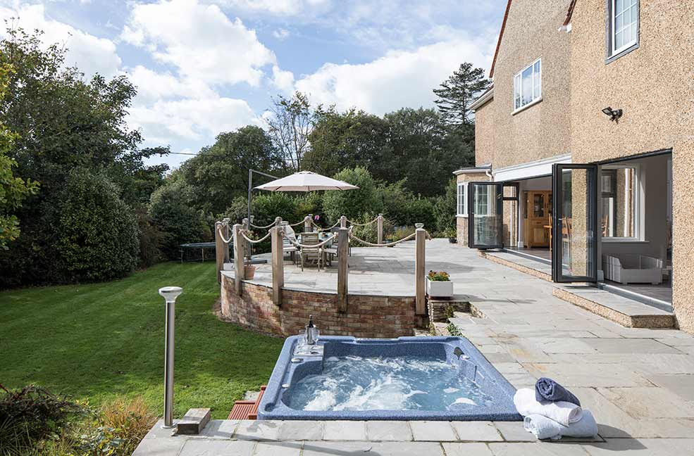The bubbling hot tub at Ridge House will be your sanctuary after a long day of walking in Hampshire.