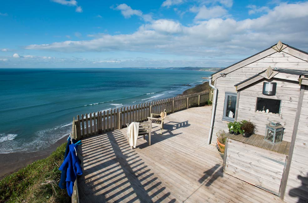 This 1930s cabin overlooks Whitsand Bay in Cornwall. Stay at Rockwater Cabin for the ultimate seaside glamping holiday.