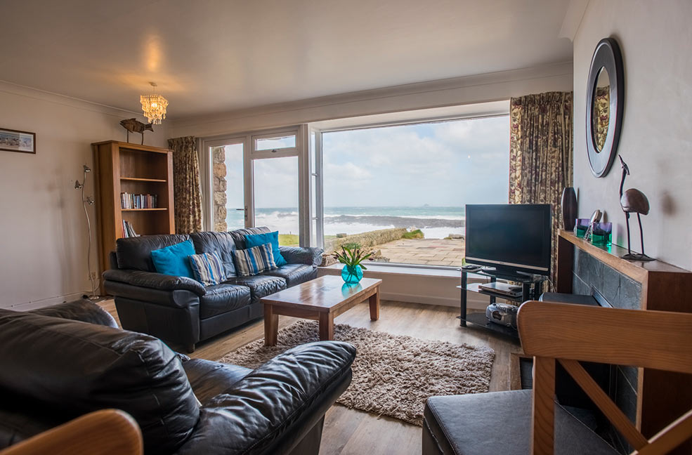 Come rain or shine, we're not sure we'd ever be able to leave the huge picture window at Oystercatcher. Look at the colour of the sea!