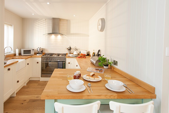 Contemporary interiors creating a calming environment to start your Isle of Wight holiday on the best note.