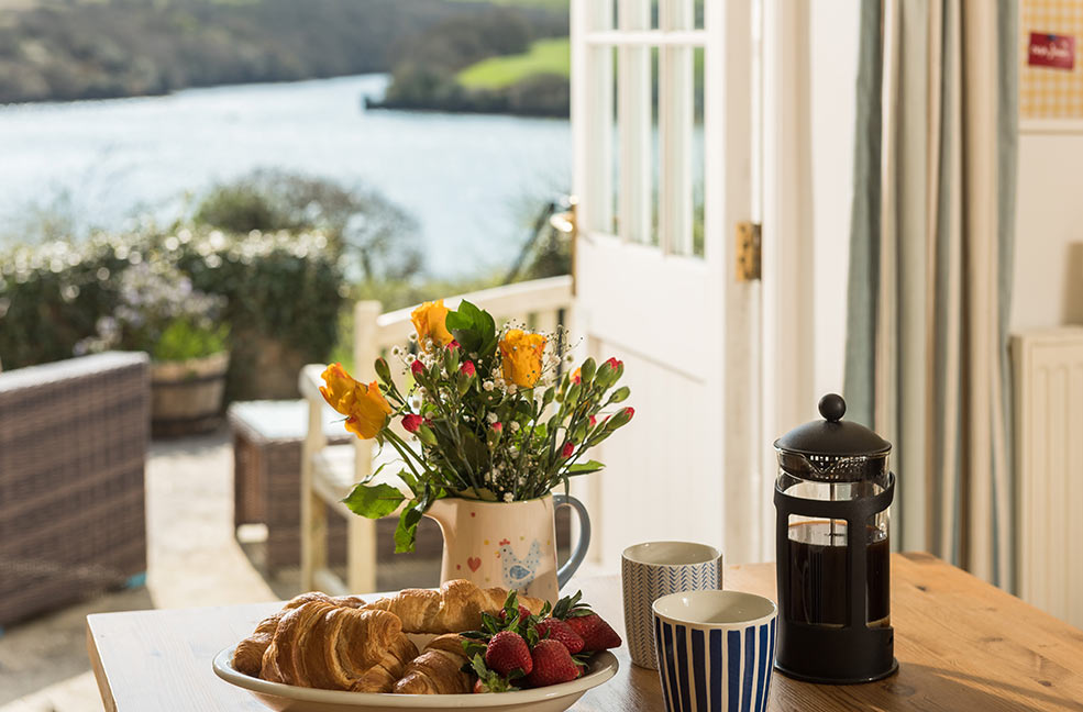 Beautiful views of the Helford river from the dining room of White Cottage.