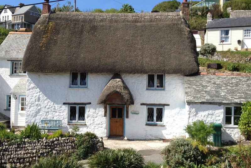 A quaint thatched cottage in one of the most beautiful coves in Cornwall.