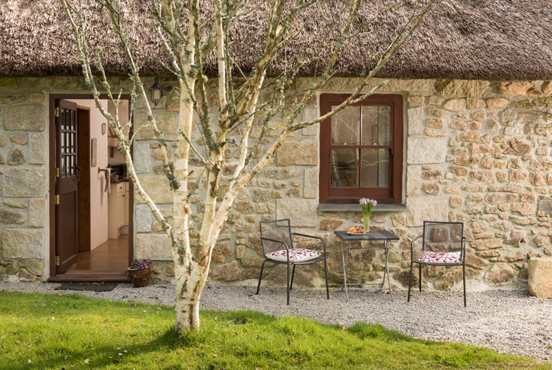 High ceilings and exposed beams are the key features of this pretty barn conversion in Cornwall.