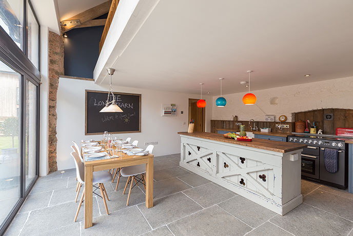 Quirky colourful touches, luxury paints and sophisticated design welcomes you to the Long Barn in Devon.