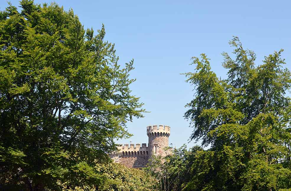The castle turret peeking out over the trees greets you as you head into the gardens.