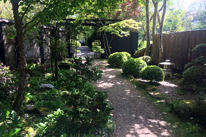 Follow the neat gravel paths through the garden as you relax in the sunshine and the scent of the blooming flowers.