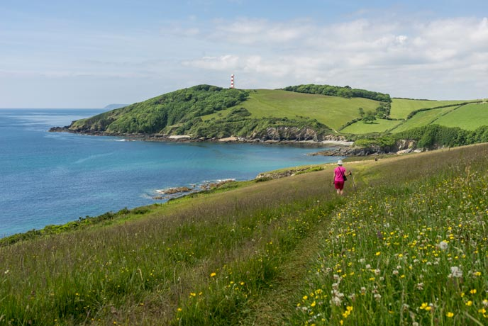 The view of Polridmouth beach from the coast path near Fowey in Cornwall.