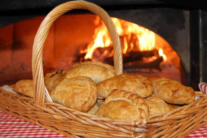 Basket of Gear Farm pasties in front of the fire