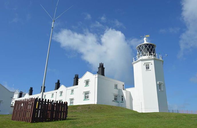 The Lizard lighthouse is a great place to learn about the coastal communities in Cornwall.