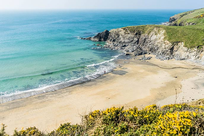 You can only reach Polurrian Cove by foot, making it a private beach for relaxing in the summer sunshine.