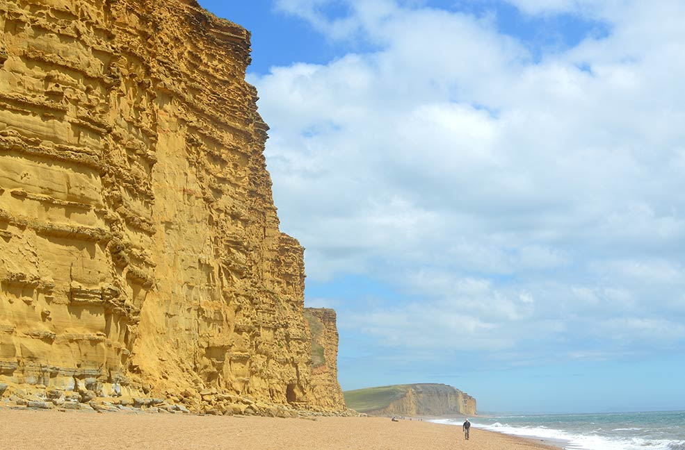 Stare out at the breathtaking views toward the Golden Cap from the beaches of West Bay.