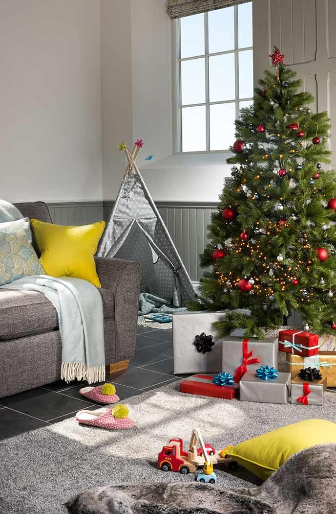 Don't forget to load up the tree with presents. Either plan in advance or buy local items as gifts.