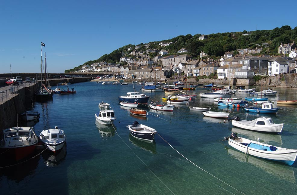 Mousehole harbour is beautiful at all times of the year. Visit in December and January to see the Christmas lights glow over the water.