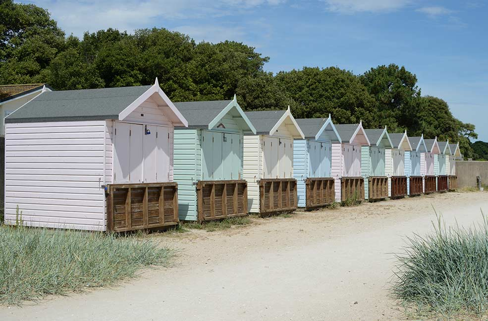 The pastel coloured beach huts on Avon beach mean summer is finally here.