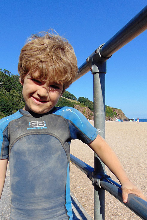 A very happy boy at Blackpool Sands in south Devon.