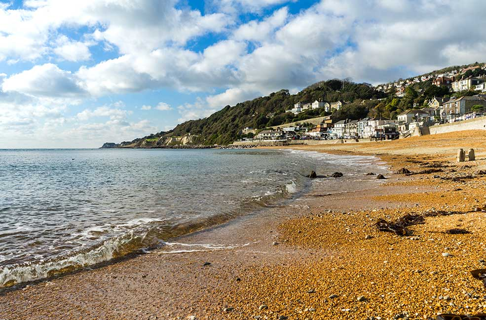 Ventnor Haven remains sheltered by the cliffs all year round, perfect for a relaxing beach walk.