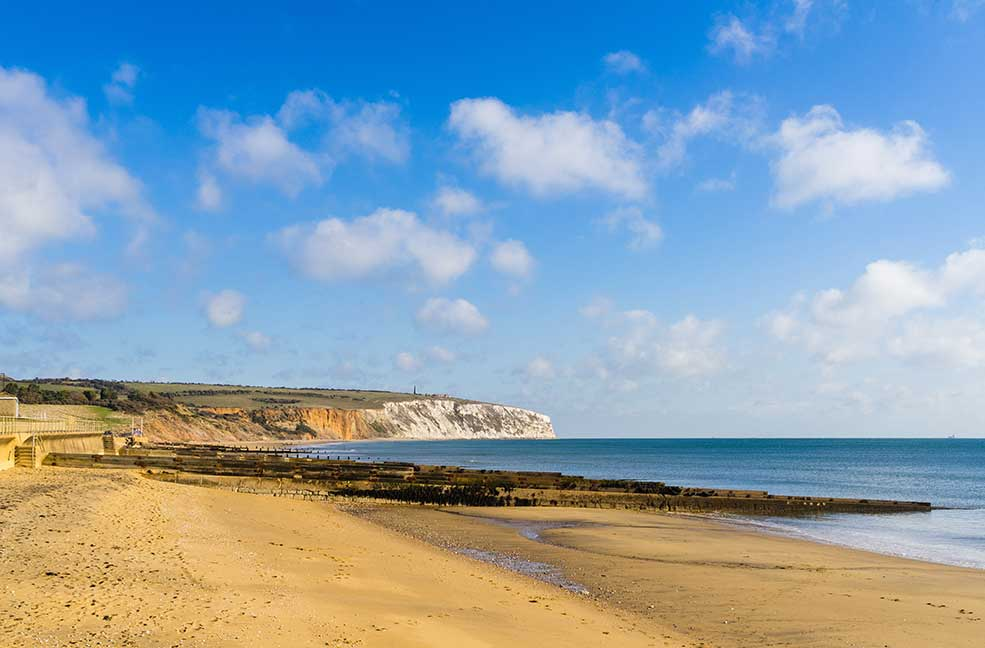Culver cliffs stand tall next to the golden sands of Sandown.