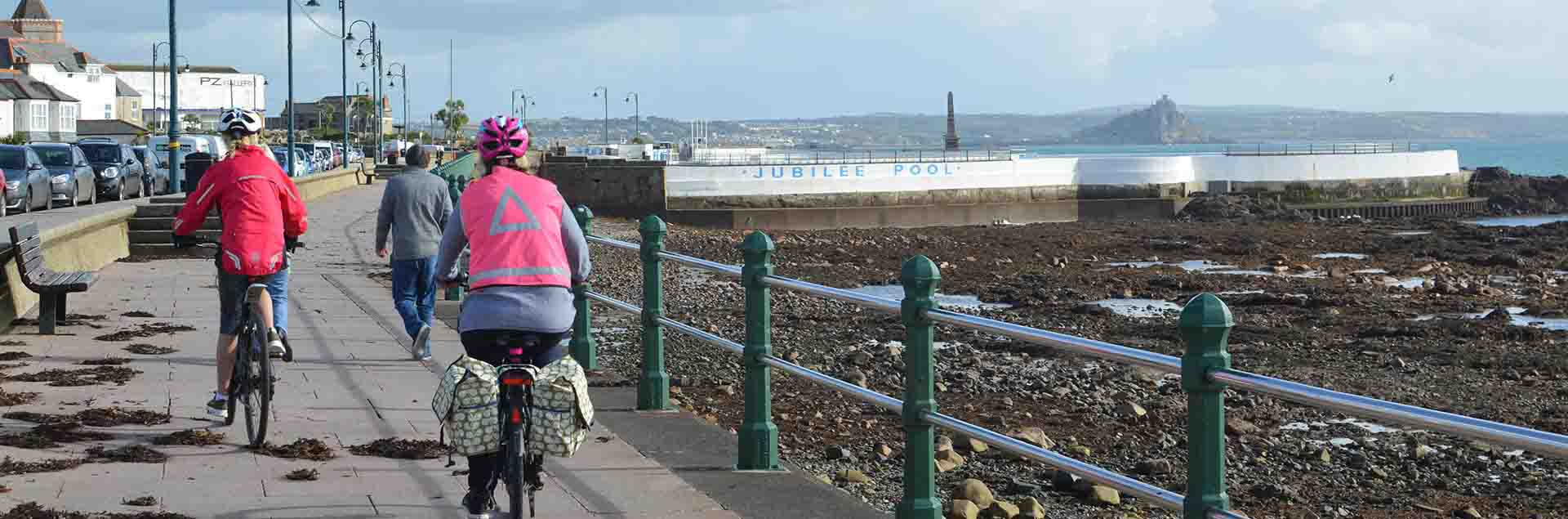 Cycling along the Penzance Promenade in Cornwall