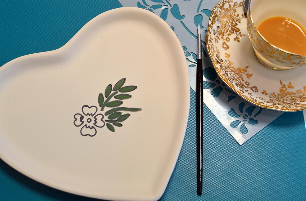 Part painted plate with an added tea break.