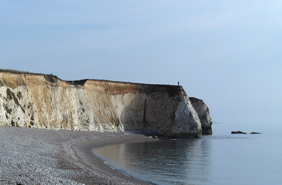 Freshwater Bay is a calm place to sit and watch the world go by on a sunny day on the Isle of Wight.