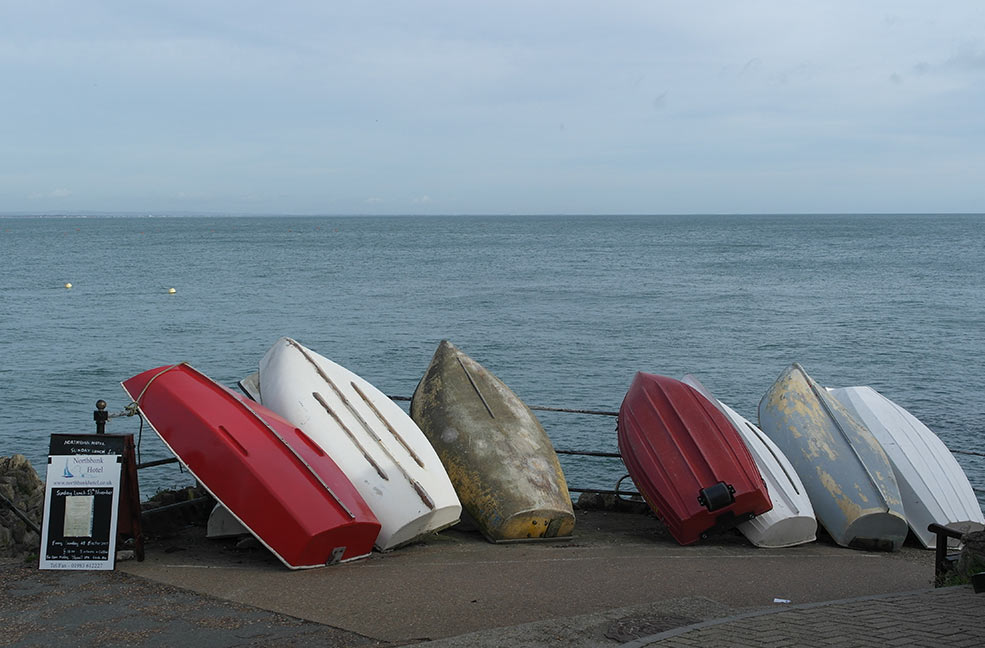 Boats lined up ready for rowing off Seaview Beach