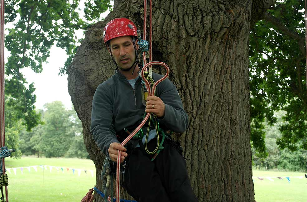 Paul from Goodleaf showing us how to tie acorn knots ready to climb trees.